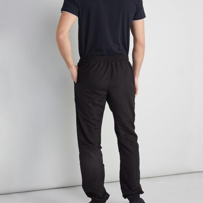 Jogging uni toile enduite homme noir
