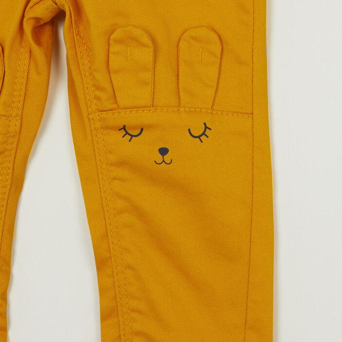 Pantalon coupe slim broderies lapin bébé fille jaune